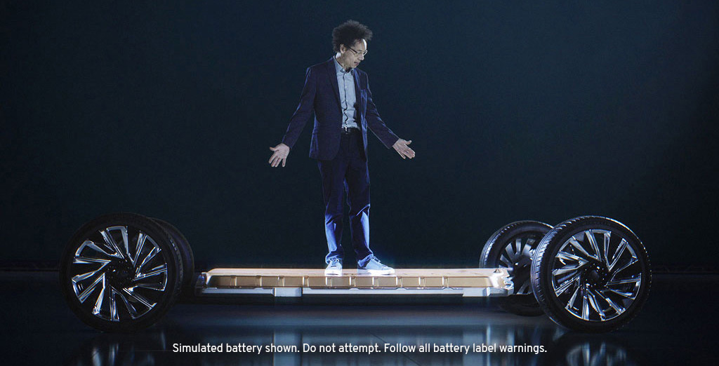 Journalist Malcolm Gladwell Standing on Top of General Motor's Revolutionary Ultium Platform Battery.