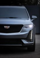 The Cadillac XT6 Sport is defined by darker accents and more aggressive, performance-inspired details, including a black grille with a specific, V-Series-inspired pattern.